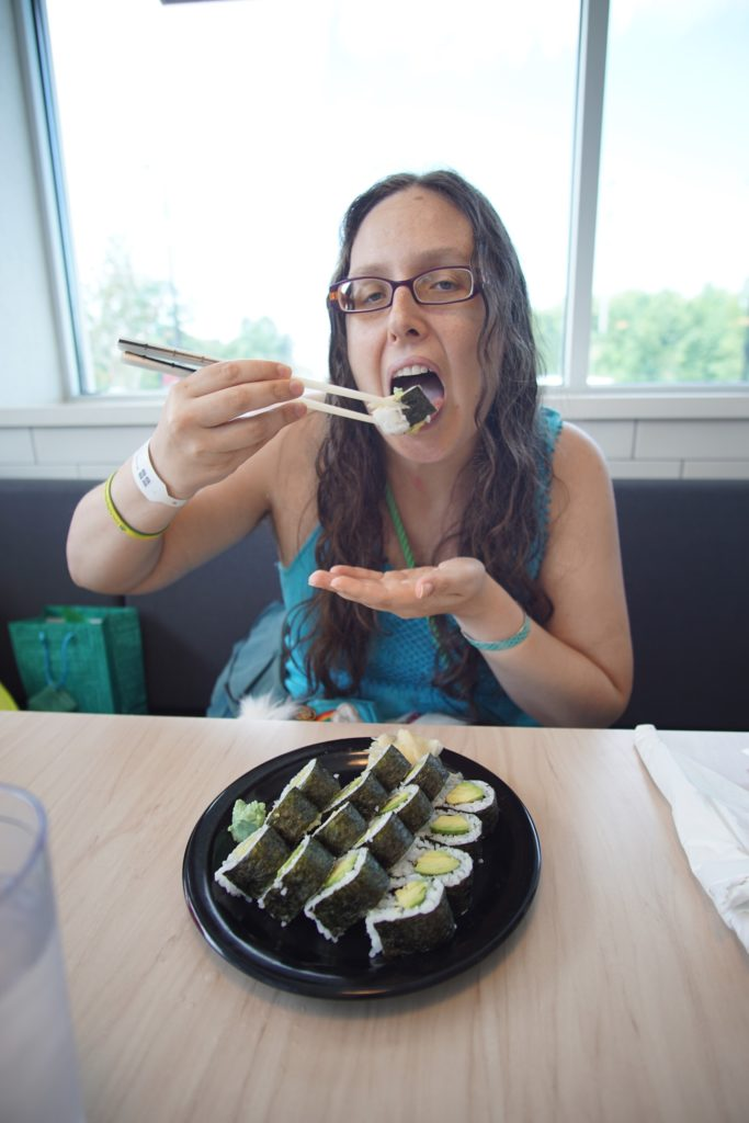 The sushi starts to enter the mouth.