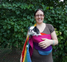 Veronica carrying Hestia in a rainbow sling