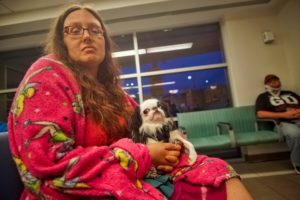 Veronica looking miserable in the ER with Hestia on her lap and the Tinkerbell blanket