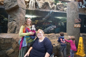 Veronica, Hestia, an Cari in front of the giant fish tank