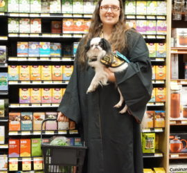 Veronica and Hestia at the grocery store in matching Hufflepuff gear