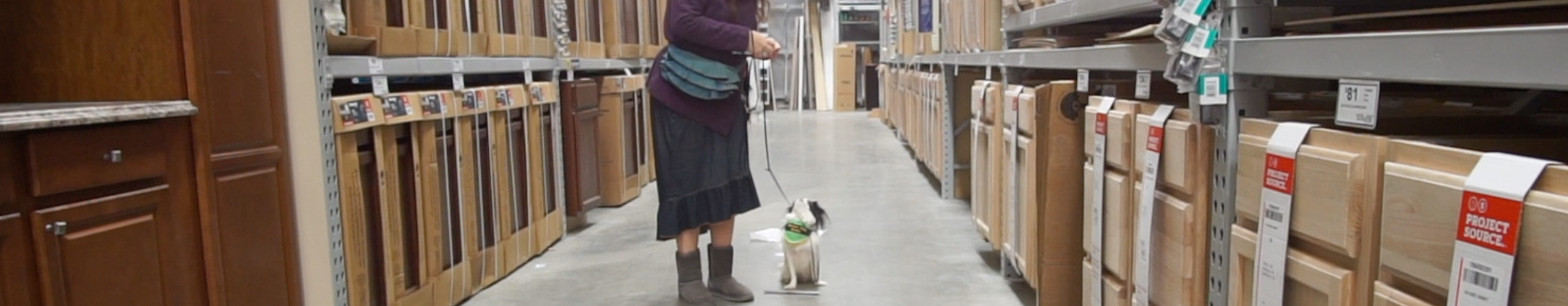 Hestia and Veronica in Lowe's ignoring trash on the floor