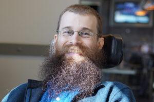 A closeup of Brad with a big bushy beard.