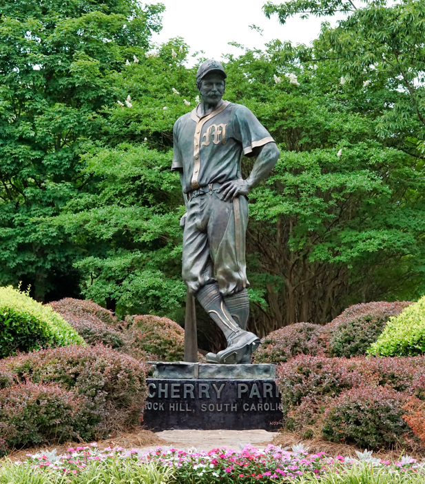 "A statue of a baseball player from the olden days. It is supposed to be Casey Jones, the fictional character from ""Casey at Bat""."