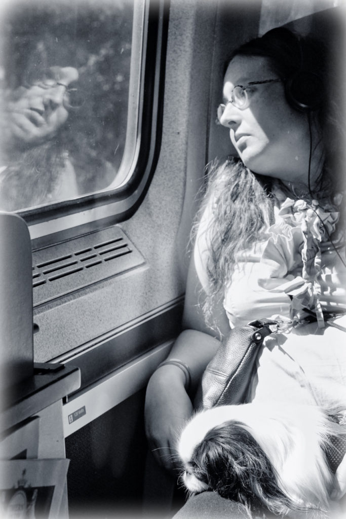 Another dreamy shot of Veronica looking out the train window.  This time, Hestia is asleep on her lap.