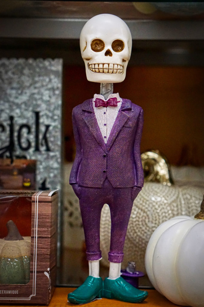 Brad found this skeleton man interesting!  He is wearing a purple suit and turquoise shoes!