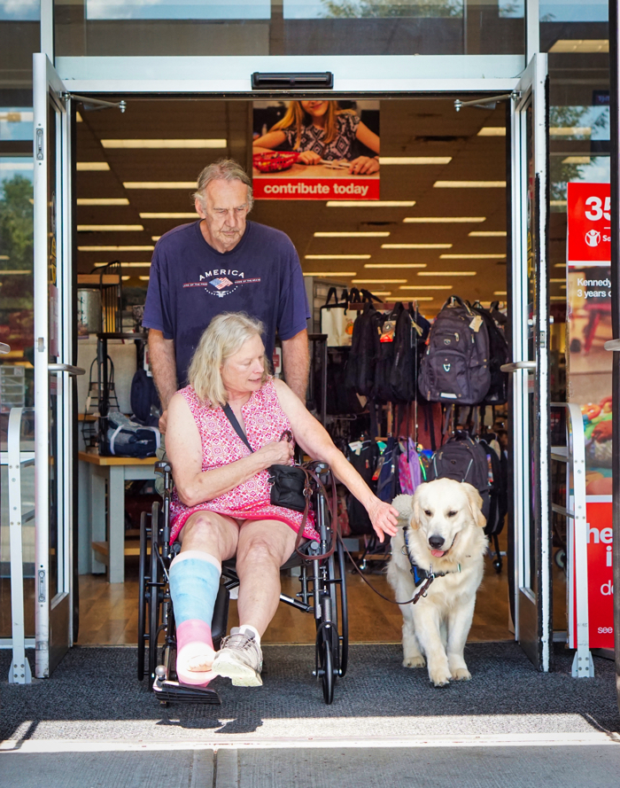 Mick, Barbara, and Tripper come out the door of TJ Maxx.