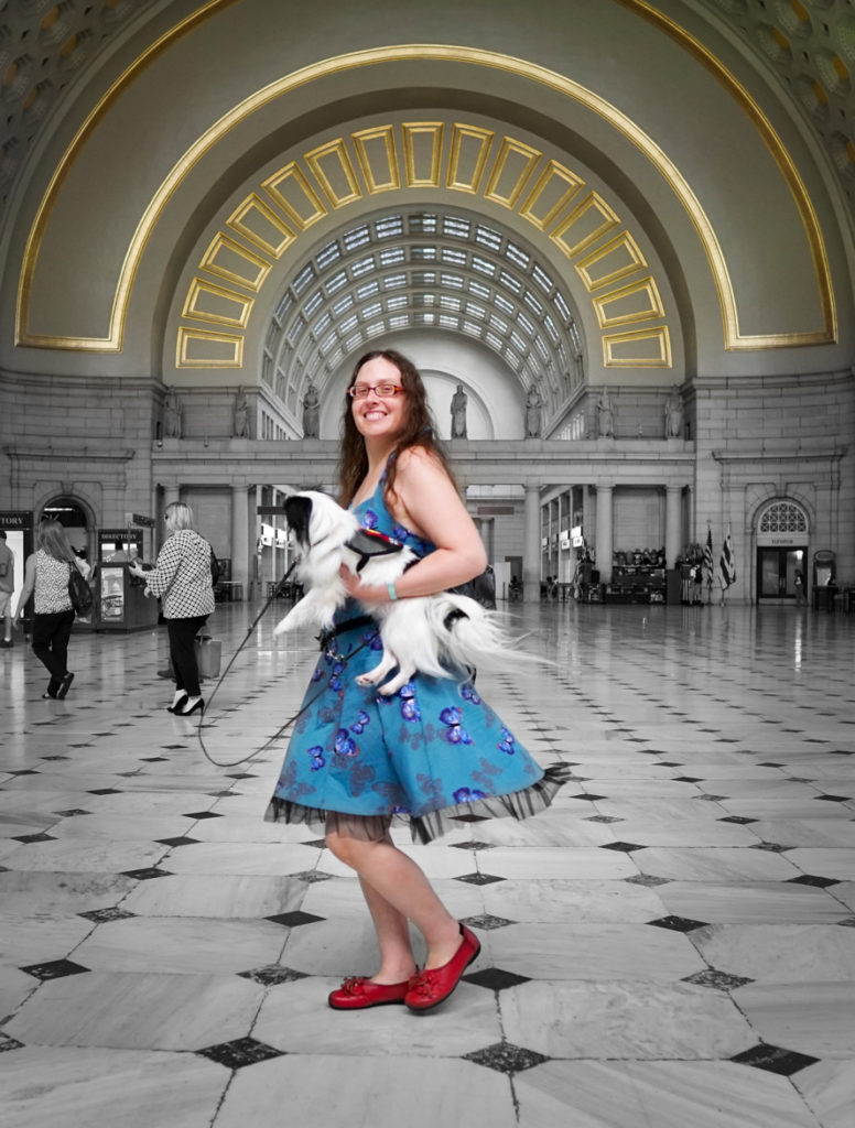 Veronica spins in the DC train station while holding Hestia.