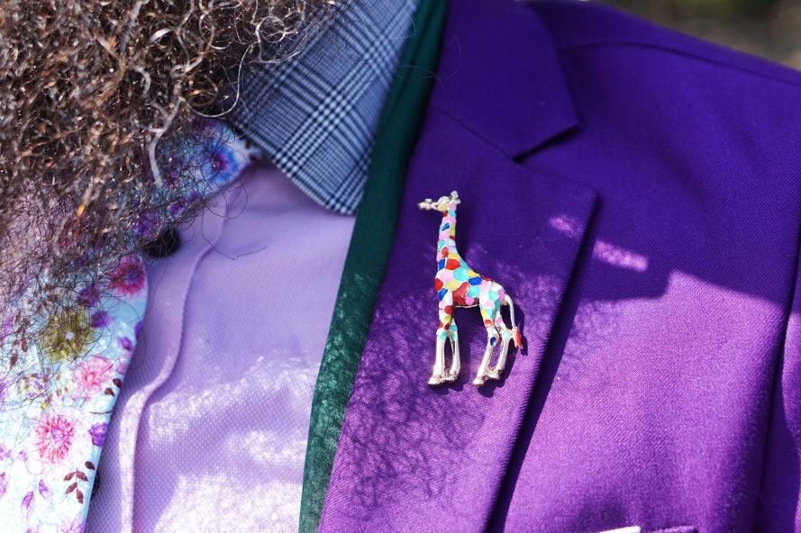 A closeup of the multicolored giraffe pin.