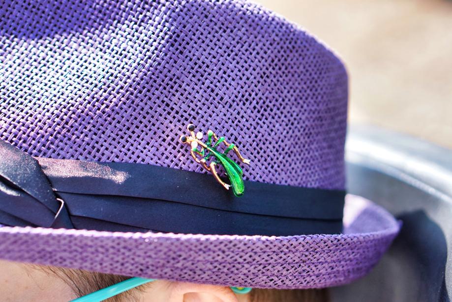 The praying mantis on Brad's hat has googley eyes like Hestia!