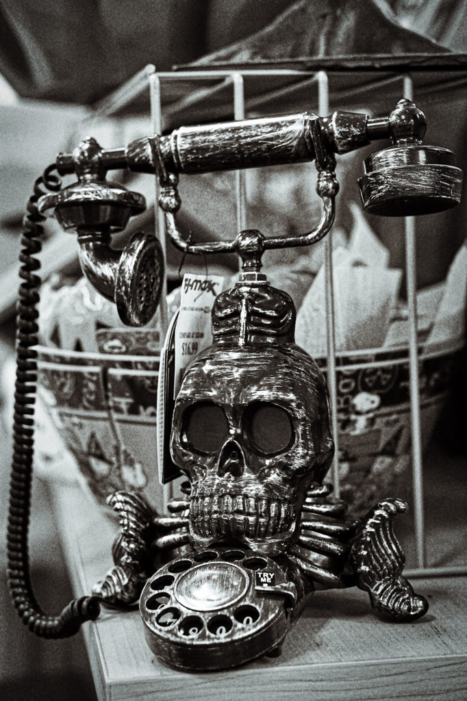 A black and white picture of a neat skull themed telephone that Brad saw in the Halloween display.