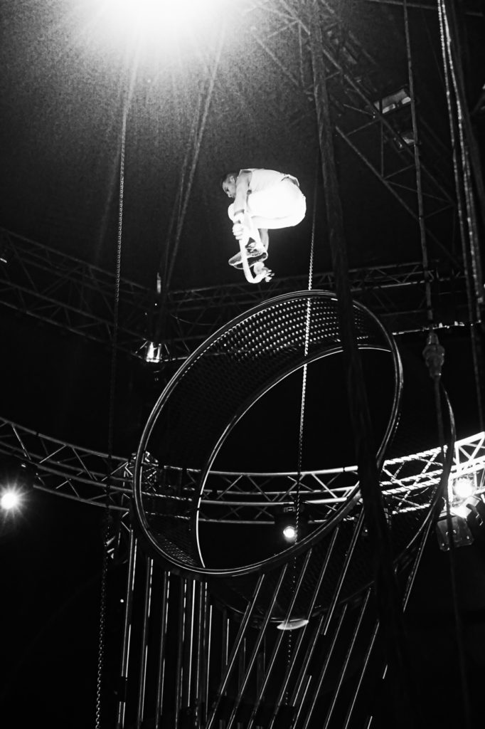 The wheel of death is again at its peak, and this time the man is on top of the wheel and jumping rope!