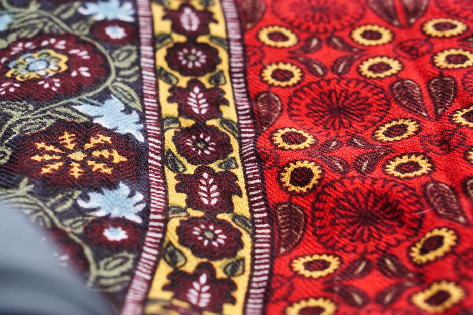 The mostly red with vaguely Indian patterned blanket of Brad's.