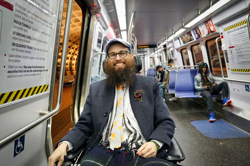 Brad smiles while on the Metro train.
