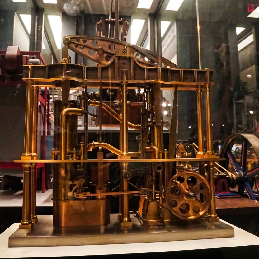 An ornate brass model steam engine.