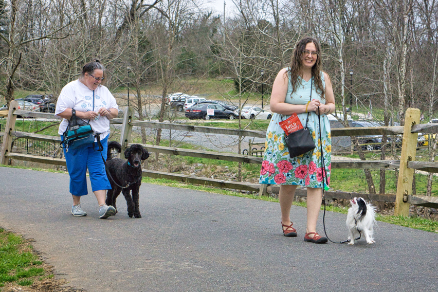 Christi with Gabby and Veronica with Hestia heeling along the trail.