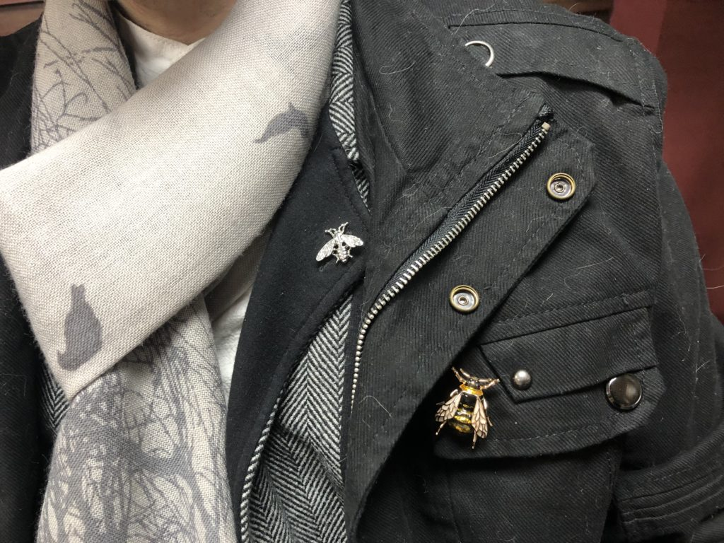 A closeup of the bee pins on Brad's lapel and coat.
