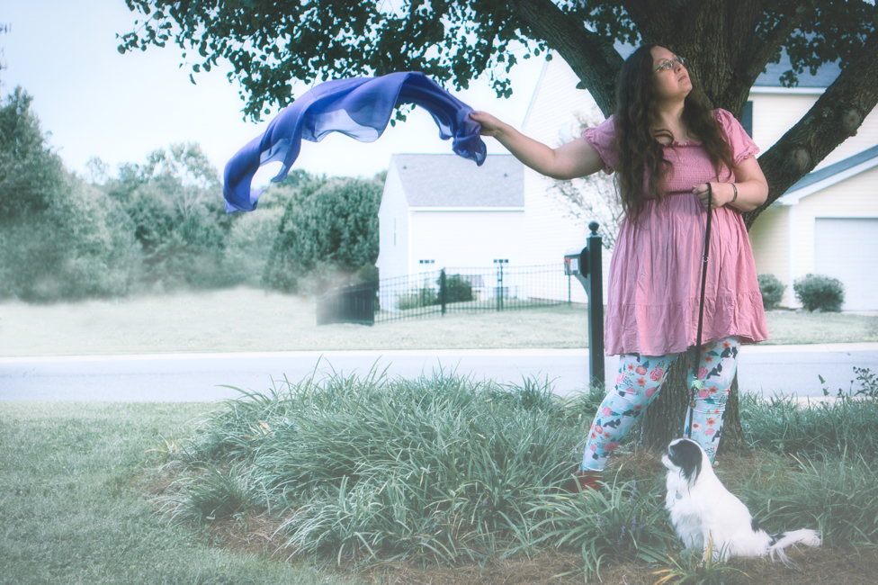 A whole street has been removed from this photo, as Veronica trails the scarf in the wind.