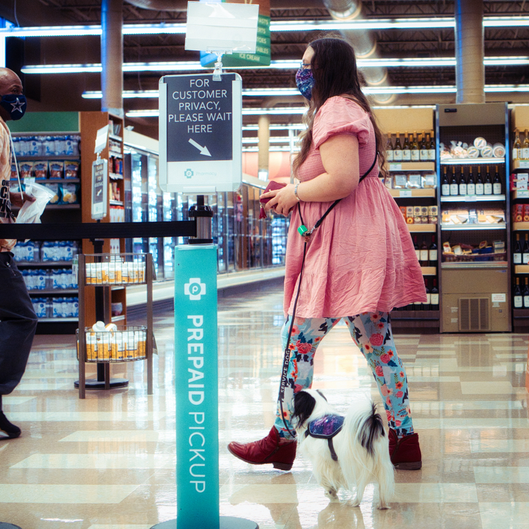 Veronica and Hestia walk over to the pharmacy counter.